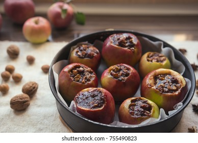 Apples stuffed with nuts and jam ready for baking in the oven