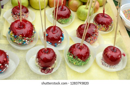 Apples in a sugary glaze on the table.This is a delicious treat for children.
