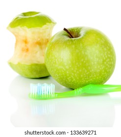 Apples with a toothbrush isolated on white
