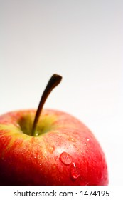 Apples with water splashes. selective focus on front waterdrops.
