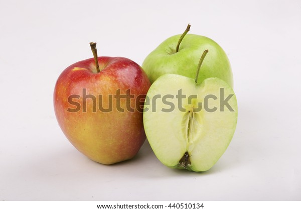 Apples whole and a half on white background
