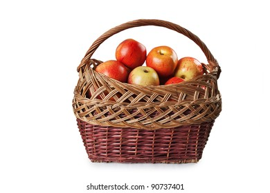 apples in a wicker basket isolated on white background