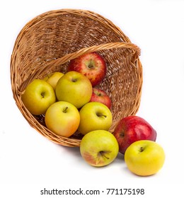apples in a wicker basket on a white background