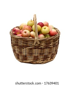 apples in woven basket isolated on white background