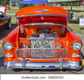APPLETON, WI - JULY 21:  The engine of an orange 1957 Chevy or Chevrolet Bel Air at the 18th Annual WVBO Classic Car Show at Fox Valley Technical College on July 21, 2012 in Appleton, Wisconsin.