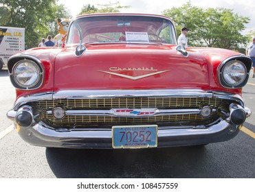 APPLETON, WI - JULY 21: Front view of a Red 1957 Chevy Chevrolet Bel Air Two Door at the 18th Annual WVBO Classic Car Show at Fox Valley Technical College on July 21, 2012 in Appleton, Wisconsin.