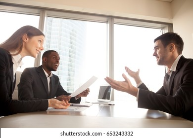 Applicant making great impression on hr managers during job interview, excited multi-ethnic recruiters surprised by impressive work achievements, shocked partners or clients amazed by business offer
