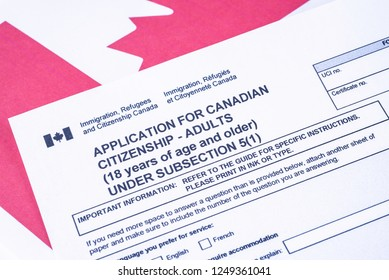 Application for Canadian Citizenship - Adults. Immigration, Refugees and Citizenship Canada form on Canadian flag surface.