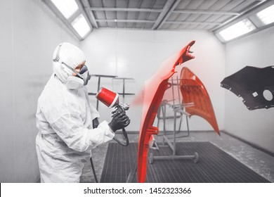 Application of first layer spray painting of the car details.
