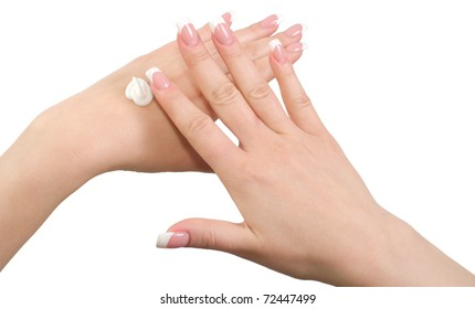 Application of hand cream isolated on white background.