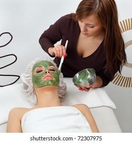 Application seaweed mask in professional studio