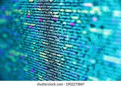 Application web source code on monitor. Big data concepts working in cyberspace environment. Code on dark background. Mobile app developer. Code of javascript language on white background