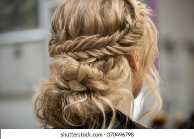 Application of wedding makeup. Boho style. Ease of braided hair braids.