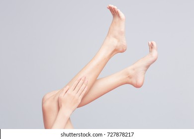 Apply lotion to the legs