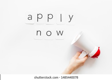 Apply now announcement symbol with megaphone and text on white background top view