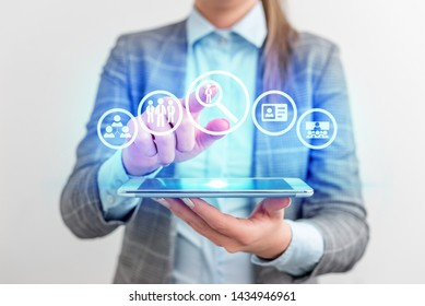 Apply now Hiring or employee needed concept with business woman using a tablet computer. Lady front presenting hand blue glow copy space text icons futuristic modern technology tech look