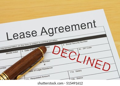Applying for a Lease Agreement Declined, Lease Agreement application form with a pen on a desk declined, bad, rejected, stamp,