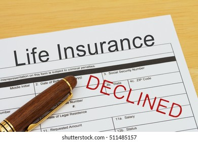 Applying for a Life Insurance Declined, Life Insurance application form with a pen on a desk with an declined stamp