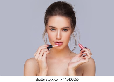 applying lip-gloss