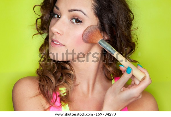 Applying make up concept, woman with cosmetic brush