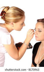 Applying makeup for a formal evening by a makeup artist