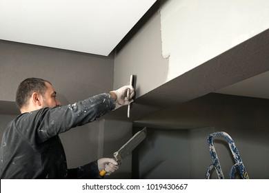 Applying Paint with Plasterer