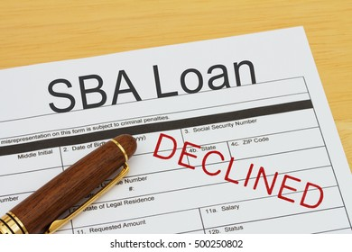 Applying for a SBA Loan Declined, SBA Loan application form with a pen on a desk with an declined stamp