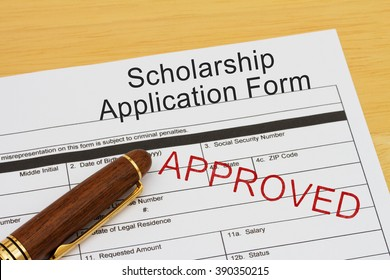 Applying for a Scholarship Approved, Scholarship Application Form with Pen on a desk