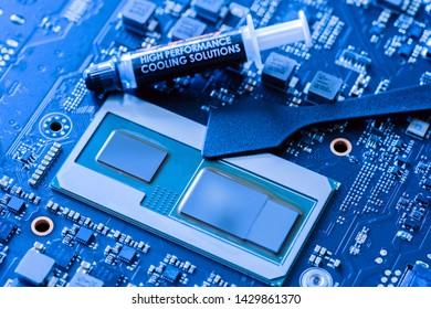 applying thermal grease to cpu closeup modern processor