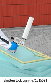 Applying a thermal insulation on a brick facade wall with foam gun
