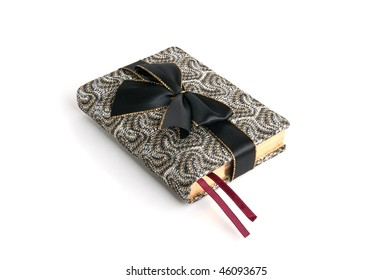 appointment book wrapped with a black bow as a gift