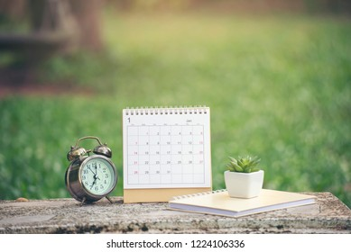 Appointment and Calendar background Concept.Desktop Calendar 2019 placed on office desk.Calender and notebook for Planner, timetable,agenda,organization,management each date,month and year.