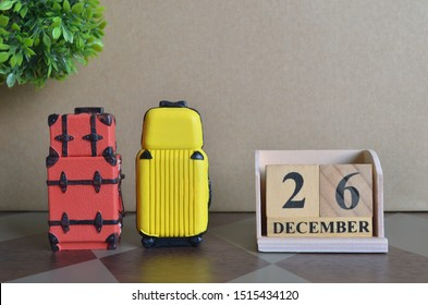 Appointment Date 26, December, Holiday, Travel cover with number cube and luggage.