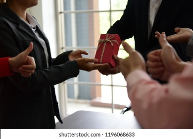 Appreciation: business corporate team congratulate colleage by giving surprise present who lead project sucess. It create high motivation, inspiration and employee satisfaction.