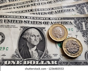 approach to american banknote of one dollar and coins of one sterling pound, background and texture