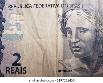 approach to a brazilian banknote of two reals, background and texture