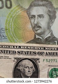 approach to chilean banknote of 1000 pesos and american banknote of one dollar