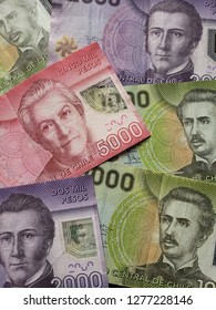 approach to chilean banknotes of different denominations, background and texture