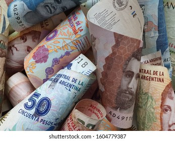approach to colombian banknotes and argentine bills of different denominations