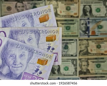 approach to swedish banknotes of twenty kronor and background with american dollar bills