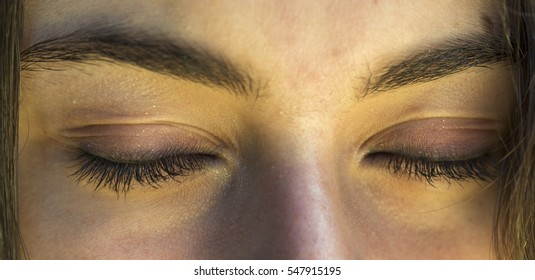 approach of two closed eyes with many details