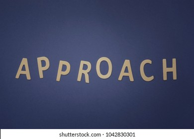 Approach written with wooden letters on a blue background to mean a business concept