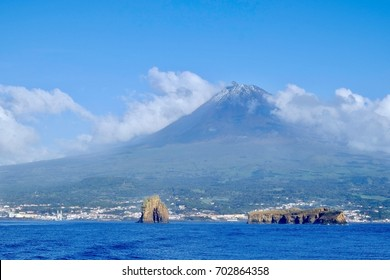Approaching Pico Island in the Azores from the sea. The volcano looms over the town of Madalena.