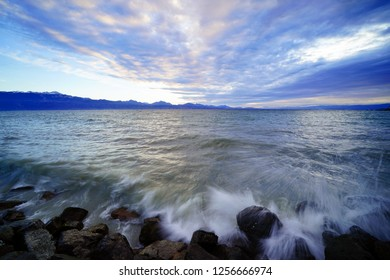 Approaching sundown by the shores of Lake Geneva (Lake Leman) on a winter's day