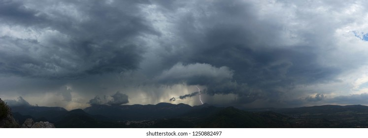 Approaching thunderstorm with lightning strike in the mountains of the South of France, near the village of Quillan