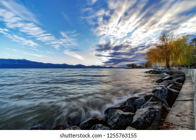 Approacxhing sundown by the shores of Lake Geneva (Lake Leman) on a winter's day