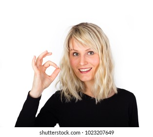 Approval - Young blond woman gives hand gesture