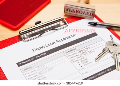Approved home loan application form close-up photo