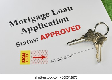 Approved Real Estate Mortgage Loan Document Ready For Signature With House Keys