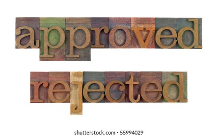 approved and rejected words in vintage wooden letterpress type blocks, stained by color ink, isolated on white